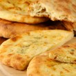 Pita breads on wooden stand close up — Stock Photo