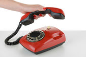 Red retro telephone, isolated on white — Stockfoto