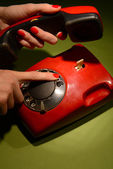 Red retro telephone on dark color background — Stock Photo