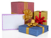 Gift boxes with blank label isolated on white — Stok fotoğraf