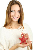 Beautiful smiling girl with Christmas star isolated on white — Stok fotoğraf