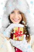 Beautiful smiling girl in hat with Christmas gift isolated on white — Stockfoto