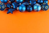 Beautiful Christmas decorations on orange background — Stock Photo
