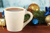 Cup of hot cacao with Christmas decorations on table on bright background — Foto de Stock