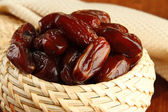 Dried dates in basket on table close up — Stock Photo
