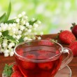 Stock Photo: Delicious strawberry teon table on bright background