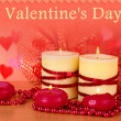 Beautiful candles with romantic decor on a wooden table on a red background — Stock Photo #35288001