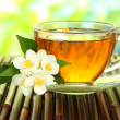 Cup of tea with jasmine, on bamboo mat, close-up — Stock Photo #35288359
