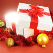 Gift box with bright light on it on red background — Stock Photo #35289001