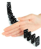 Hand stopping dominoes falling isolated on white — Stock Photo