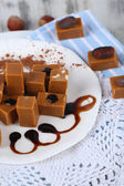 Many toffee on plate on napkins close-up — Stock Photo