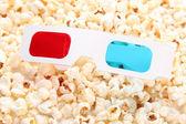 3D glasses on popcorn background — Stock Photo