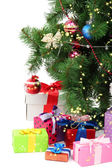Decorated Christmas tree with gifts isolated on white — Stock Photo
