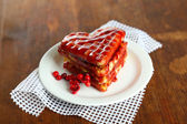 Sweet Belgium waffles with jam, on wooden table background — Stock Photo