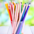 Colorful pencils in glass on wooden table on natural background — Stock Photo #35298009