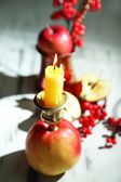 Composition with apples and candles on wooden background — Stock Photo