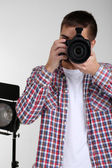 Handsome photographer with camera — Stock Photo