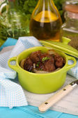 Fried chicken livers in pan on wooden table close-up — Stock Photo