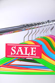 Wooden clothes hangers as sale symbol — Stock Photo