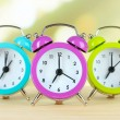 Colorful alarm clocks on table — Stock Photo