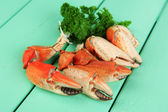 Boiled crab claws ,on wooden table background — Stock Photo