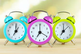 Colorful alarm clocks on table — Foto Stock