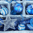 Christmas toys in wooden box close-up — Stock Photo #35329367