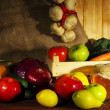 Composition of different fruits and vegetables on table on sackcloth background — Stock Photo