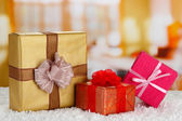 Gift boxes on rug — Stock Photo