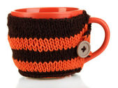 Cup with knitted thing on it — Stock Photo