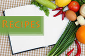 Cooking concept. Groceries with empty cookbook close up — Stock Photo