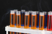 Laboratory test tubes on black background — Foto de Stock