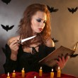 Foto Stock: Halloween witch on dark background