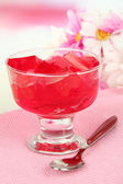 Tasty jelly cubes in bowl on table on light background — Stock Photo