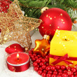 Yellow candle with christmas decoration — Stock Photo #35366597