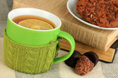Cup of tea with knitted thing on it close up — Stock Photo