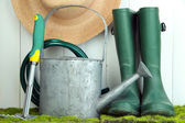 Gardening tools on grass — Stock Photo