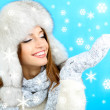 Beautiful smiling girl in hat and mittens — Stock Photo #35378613