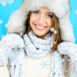 Beautiful smiling girl in hat and mittens — Stock Photo #35378609