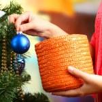 Decorating Christmas tree on bright background — Stock Photo #35378927