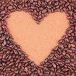 Heart of sunflower grains in chocolate, on brown background — Stock Photo #35379537