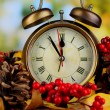 Old clock on autumn leaves on wooden table on natural background — Zdjęcie stockowe #35379615