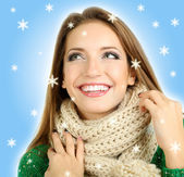 Beautiful smiling girl in warm knit scarf — Stock Photo