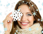 Beautiful smiling girl with Christmas snowflake — Stock Photo
