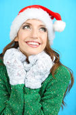 Beautiful smiling girl in New Year hat — Stock Photo