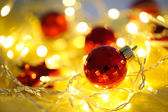 Christmas ornaments and garland close-up — Stock Photo