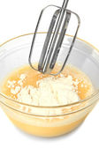 Cooking, whipping eggs with electric whisk in bowl, close up — Stock Photo