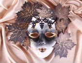 Mask on golden fabric background — Stock Photo