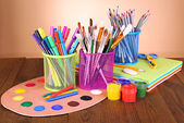 Composition of various creative tools on table on beige background — Stock Photo