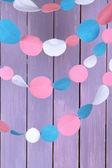 Decorative felt garland on wooden background — Stock Photo